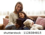 young mom  daughter and dog... | Shutterstock . vector #1128384815