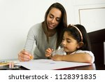 young mom and daughter doing... | Shutterstock . vector #1128391835