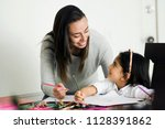 young mother and her daughter... | Shutterstock . vector #1128391862
