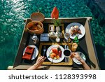 breakfast in swimming pool ... | Shutterstock . vector #1128393998