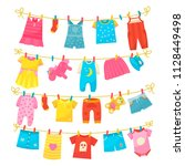 children clothes on rope. kids... | Shutterstock .eps vector #1128449498
