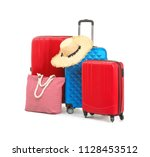 packed suitcase with hat and... | Shutterstock . vector #1128453512