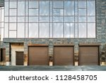 automatic lift gates to garage... | Shutterstock . vector #1128458705