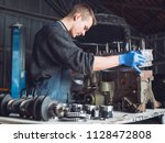 master collects a rebuilt motor ... | Shutterstock . vector #1128472808