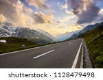 alps mountains landscape during ... | Shutterstock . vector #1128479498