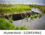 water drain on old dam | Shutterstock . vector #1128514862