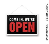 hanging sign with text come in  ... | Shutterstock .eps vector #1128523592