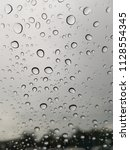 rain drops on the windshield. | Shutterstock . vector #1128554345