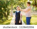 mom daughter schoolgirl... | Shutterstock . vector #1128602006