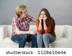 man comforting woman sitting on ... | Shutterstock . vector #1128610646