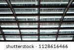raindrops on glass roof. view... | Shutterstock . vector #1128616466