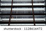 raindrops on glass roof. view... | Shutterstock . vector #1128616472