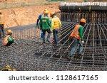 a reinforced steel re bar ... | Shutterstock . vector #1128617165