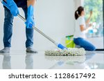 cleaning service concept.... | Shutterstock . vector #1128617492