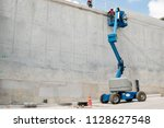 boom lift at water concrete... | Shutterstock . vector #1128627548