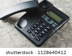 desk phone with handset on old... | Shutterstock . vector #1128640412