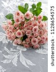 lying bouquet roses with petals ... | Shutterstock . vector #1128654575