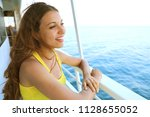 beautiful smiling woman on... | Shutterstock . vector #1128655052