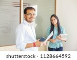 indian business team of two... | Shutterstock . vector #1128664592