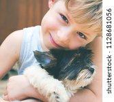 happy caucasian boy lovingly... | Shutterstock . vector #1128681056