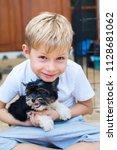 happy caucasian boy lovingly... | Shutterstock . vector #1128681062