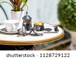 closeup of table with used... | Shutterstock . vector #1128729122