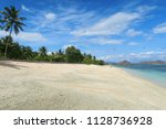 white sand clear beach with... | Shutterstock . vector #1128736928