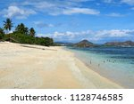 white sand empty clear beach... | Shutterstock . vector #1128746585