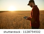 smart farming using modern... | Shutterstock . vector #1128754532
