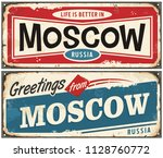 retro tin sign with greetings... | Shutterstock .eps vector #1128760772
