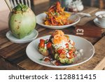 smashed avocado toast with...   Shutterstock . vector #1128811415