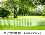 green tree and green grass in... | Shutterstock . vector #1128834728