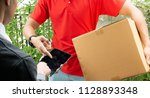 delivery man using tablet... | Shutterstock . vector #1128893348