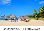 Small photo of Beautiful beach with palm trees, Praia do Amor, near Pipa, Rio Grande do Norte, Brazil
