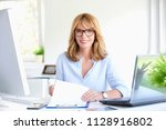 shot of a beautiful middle aged ... | Shutterstock . vector #1128916802