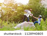 happy two middle aged in forest.... | Shutterstock . vector #1128940805
