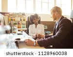 colleagues having a... | Shutterstock . vector #1128960038