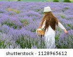 girl is in the lavender field ... | Shutterstock . vector #1128965612