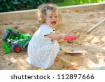 girl is playing in a sandbox | Shutterstock . vector #112897666