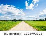 a view of a dirt road through... | Shutterstock . vector #1128993326