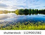 reflections on the water. a... | Shutterstock . vector #1129001582