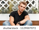 handsome fashionable guy with a ... | Shutterstock . vector #1129007072