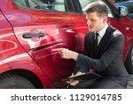 insurance agent filling... | Shutterstock . vector #1129014785