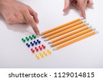 a person's hand arranging... | Shutterstock . vector #1129014815