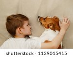 cute little boy and jack... | Shutterstock . vector #1129015415