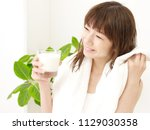 asian woman drinking milk | Shutterstock . vector #1129030358