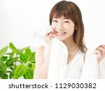 smiling asian woman with towel | Shutterstock . vector #1129030382