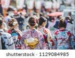 woman wearing a kimono in kyoto ... | Shutterstock . vector #1129084985