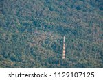 television tower in the forest. | Shutterstock . vector #1129107125