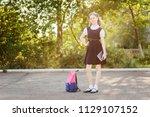 beautiful schoolgirl with... | Shutterstock . vector #1129107152